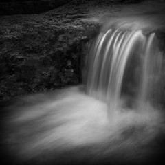 vannfall (H o g n e) Tags: autumn bw fall water rock creek river dark landscape blackwhite waterfall smooth movingwater flowingwater smoothwater