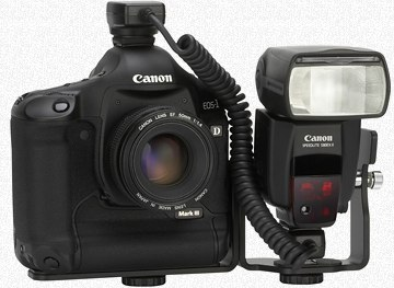 Photo of the Canon 1D Mark III plus 580EX II Speedlite mounted on the Canon SB-E2 bracket