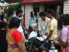 Food Material is being distributed (samparkvibhag-RSS) Tags: rescue india for rss flood relief operations areas activity andhra 2009 floods pradesh affected andhrapradesh floodrelief sevabharathi