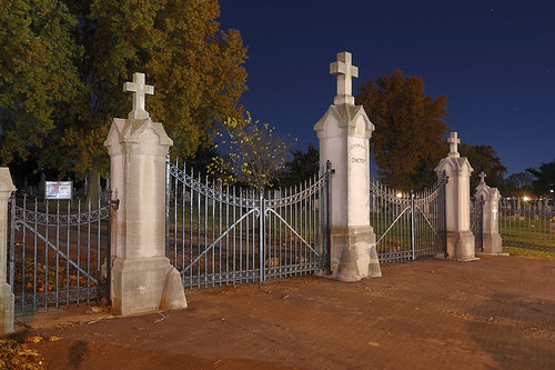 Saints Peter and Paul Roman Catholic Cemetery, in Saint Louis, Missouri, USA - view of cemetary gates at night with stars