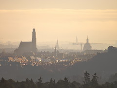 Stockholm from Haga Hill (merfloro) Tags: city autumn trees haze cityscape stockholm churches telephoto lowsun engelbrekt adolffredrik