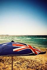 parasol (julianleach) Tags: ocean film beach umbrella lca xpro lomography crossprocess flag australia lomolca parasol analogue aussie goldcoast kokakelitechrome100