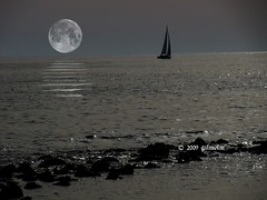 Escape from the Moon (gilmolm) Tags: moon sea escape ostia rome reflection canonpoweshotsx110is canon lidodiostia lidodiroma roma italy mare rock scogli riflesso photoshop barca boat giannitogni luna vela sail abigfave 1001nights platinumheartaward concordians uniqueaward flickrestrellas photographyrocks platinumbestshot quarzoespecial the4elements mywinners