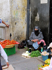 Moroccan Tomato Lady (cwgoodroe) Tags: tangier tanger morocco moroccan africa ferry plane bus doorway arab muslim mosque merchant street arabic metaldoors colors summer streetlife vibrant poor kasbah casbah casbha ancient moors christians fishmerchant artistic ocean city sea sand sun panasonic pentax continent people script merchants children metal doors colorful conservative fish monger cafe friendly vegtable old cleric casba dailylifeportrait sadfaces hijab