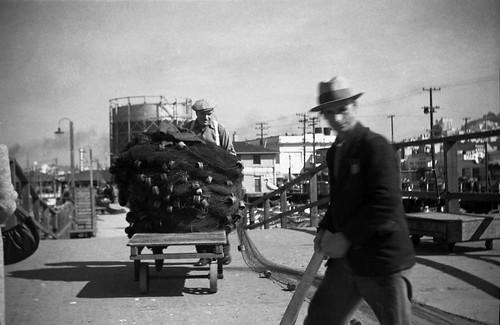 Pushing Pile of Fishing Nets 1941