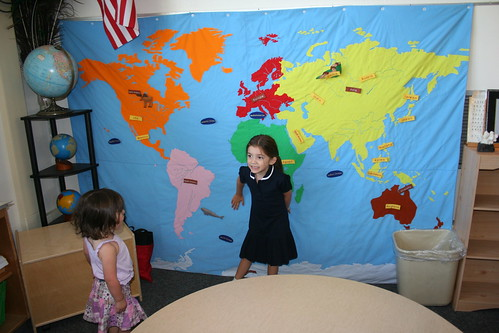 In front of the CUTEST map ever in her classroom!