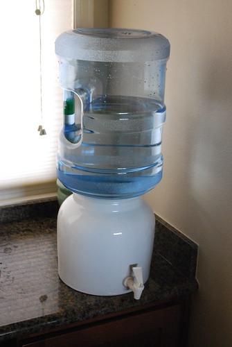 My spring water setup at home. I bought the ceramic base and polycarbonate 5-gallon jug from Whole Foods. Total cost was $50. Water was free though :) .