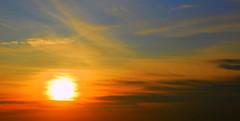 windswept sunrise (ankakay) Tags: morning blue orange sun yellow clouds sunrise dawn nikon nikkor wispy daybreak d80 nikond80