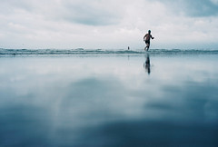 wet sand reflection (lomokev) Tags: sea reflection beach swimming landscape sand nikon kodak low ground explore groundlevel frontpage nikonos wetsand ektar ratseyeview deletetag nikonosv nikonos5 kodakektar100 nikonosfive roll:name=090724nikonosvektar file:name=090724nikonosvektar65 yahoo:yourpictures=reflections
