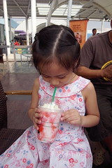 Her drink matches her dress (HunnieBunch) Tags: starbucks skygarden smnorthedsa forchristmas giftshopping