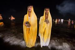 Force of belief (Ashish T) Tags: ocean sea woman sun india men colors festival night canon lowlight women worship colorful indian religion tokina celebrations ritual mumbai hindu hinduism puja prayers 1224 chhath 40d socialaffairs ashishtibrewal