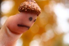 Remembrance (Hutima) Tags: autumn fall reflecting sad bokeh finger acorn acting thumb