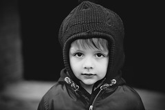 Oscar and The Sound of Silene (marinasantos6) Tags: london city blackandwhiteportrait blackandwhite naturallight outdoor amor love depthoffield blurred bokeh clapham flickrsbest flickraddicts depth lens eyes canon5dmarkii niño canon oscar portrait face boy canon85mm family children kids
