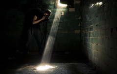photographers underground (Crazy Ivory) Tags: lighting camera light boy portrait urban sun sunlight color reflection building berlin guy green rot texture industry broken colors beautiful wall backlight contrast darkroom photoshop canon buildings reflections germany dark paper underground person lights licht amazing nikon colorful shoot industrial alone ray hand darkness bokeh candid rusty structure dirty east dirt shooting unusual 1855mm grn dust visible dslr solitary vignette rayoflight konstantin lightray hohenschnhausen lightstream bigroom 400d canoneos400d canoneos400dcanon rasenkantenstein smallamountoflight gettyimagesgermanyq1 gettygermanyq2 gettygermanyq3 gettygermanyq4