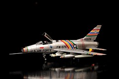 "HobbyMaster model of United States Air Force (USAF) North American F-100C ""Super Sabre"" personal aircraft of Colonel George Laven, Jr., CO, 479th Tactical Fighter Wing, and World War II ace. (Ivan S. Abrams) Tags: corgi nikon republic dragon aircraft airplanes f100 sabre boeing mustang phantom douglas lockheed fairchild gemini texan mig at6 warthog t6 snj mcdonnell lighning curtiss grumman avenger smrgsbord mcdonnelldouglas modelairplanes mig21 starfighter airplanemodel georgeairforcebase helldiver modelaircraft northamericanaviation f100c hobbymaster supersabre mikoyangurevich thunderboltii skymax diecastmodels curtisswright fairchildrepublic williamliu lavochkin onlythebestare northamericanrockwell 172scale ivansabrams nikond700 modeldiecast nikon24120mmf3556gvr scale172 georgelavenjr georgelaven 479thtfw la5n nikkor24120mmf35mmf3556gvr abramsandmcdanielinternationallawandeconomicdiplomacy ivansabramsarizonaattorney ivansabramsbauniversityofpittsburghjduniversityofpittsburghllmuniversityofarizonainternationallawyer"