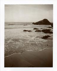 . (Rebecca...) Tags: uk sea film beach water polaroid evening rocks cornwall empty horizon stagnes landcamera wavelet trevaunancecove polapremium polaroidautomatic450 1500asa sepia100film 450sepia0310