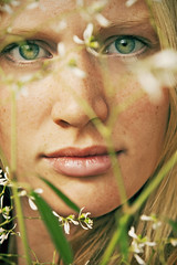 Through the Looking Grass (Amanda Carlsson) Tags: pink red portrait woman white selfportrait plant amanda flower color colour green girl beautiful rose mouth hair nose leaf petals eyes pretty cheek 21 sweet young grow fair calm lips hide behind carlsson frecles