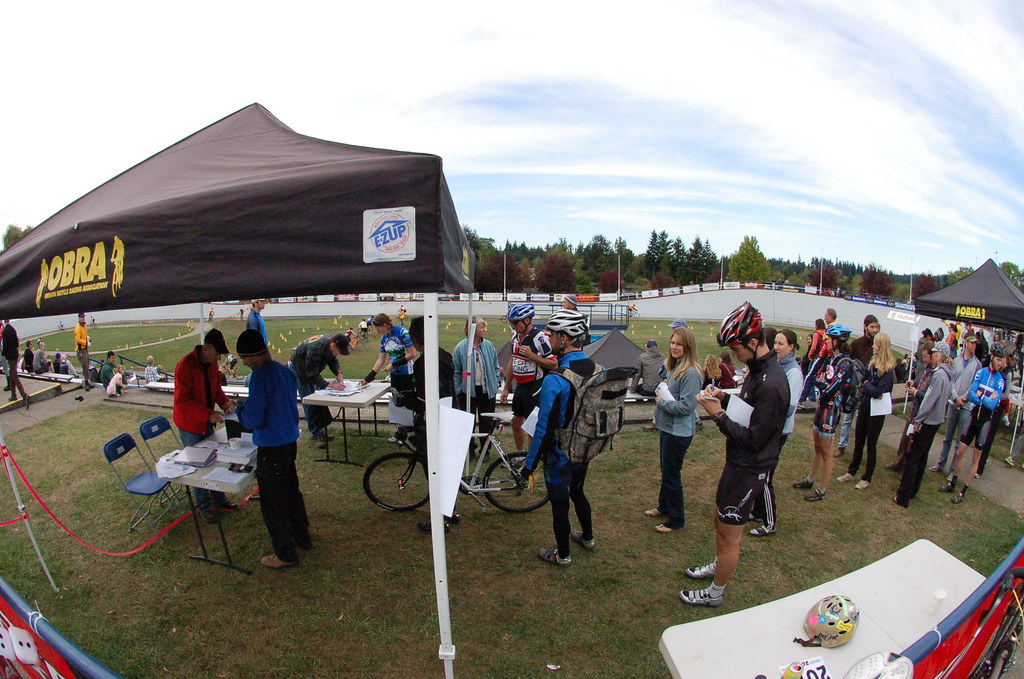 Cross racers lined up at the registration tent to get signed in and numbers for the race