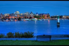 Victoria, British Columbia Blue Hour (Brandon Godfrey) Tags: pictures old city blue light urban canada detail reflection building tower beach water colors grass skyline plane buildings reflections bench boats photography lights harbor twilight colorful downtown colours bc bell photos harbour pics path britishcolumbia sony magic details horizon victoria canadian belltower vancouverisland hour creativecommons planes pacificnorthwest northamerica bluehour colourful jupiter alpha dslr thefalls hdr highdynamicrange pathway buoy royalbritishcolumbiamuseum vicwest innerharbour songhees thebluehour a300 rbcm photomatix theempresshotel tonemapped tonemapping dslra300 sonya300 thebelmontbuilding