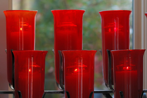 Red votive lamps, at Saint Peter Roman Catholic Church, in Saint Charles, Missouri, USA