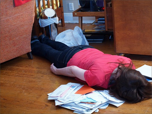 Face down on a pile of mail & stuff by TheeErin, on Flickr