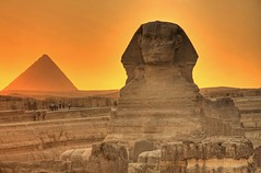The Sphinx and Menkaure (Matt Champlin) Tags: life old sunset people orange history archaeology nature sphinx mystery clouds canon landscape temple glow quiet small lion egypt peaceful carving tiny egyptian temples mysterious historical pyramids giza greatpyramidsofgiza abigfave bestofmywinners