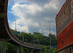 Ramp & West Bottoms, 9 May 2011 (photography.by.ROEVER) Tags: morning bridge building architecture ramp may onramp viaduct kansascity kc oldbuilding i70 i35 kcmo westbottoms kansascitymo 2011 kansascitymissouri downtownloop may2011 standardseedbuilding