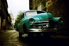 modern inconveniences (0bli0) Tags: leica car turquoise havana cuba overcast cobblestones capitol m8 nophotoshop aftertherain lateafternoon lahabanavieja missingwheel voigtlandernokton35mmf12aspherical brokenheadlight brokenindicator