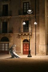 a foot illuminated (michelemirko) Tags: city light italy canon europa europe italia sicily 2009 sicilia siracusa manolibera michelemirko