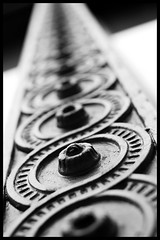 Infinity (Eric Flexyourhead) Tags: bw canada detail window architecture vancouver blackwhite downtown pattern bc bokeh britishcolumbia circles curves frame arcs heritagebuilding penderstreet sigmaaf30mmf14exdchsm olympuse3
