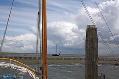 Sail boats (The Family Dog) Tags: sea sky lines clouds waddenzee boats sailing ships horizon north sail mast nautical