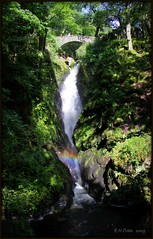 Aira Force Spraybow (Russ Cribb) Tags: shadow nature sunshine waterfall rainbow force lakedistrict spray bow cumbria 2009 airaforce aira spraybow