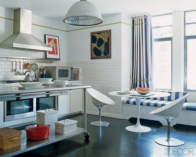 Modern white kitchen: Saarinen table + window seat + Philippe Starck chairs, from Elle Decor