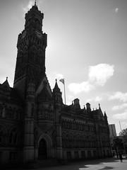 Sun behind the city hall