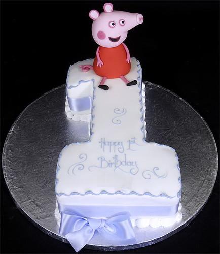 Peppa Pig Model on Figure One Birthday Cake