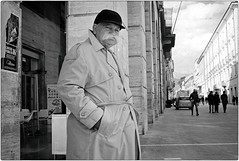 Never Trust a Man in a Trench Coat (Steve Lundqvist) Tags: street streetphotography fujifilm x100s candid eyecontact shot old man poor walking winter elderly aged age people wise wisdom hat cappello coat blackandwhite bw italy italia trench raincoat cap mustache baffi personaggio character impermeabile monochrome disappointing disappointed snap teramo abruzzo