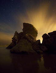 About face (Zeb Andrews) Tags: longexposure nightphotography night clouds oregon stars landscape coast eerie pacificocean nighttime pacificnorthwest bandon seastack bluemooncamera zebandrews canon5dii zebandrewsphotography lookslikeacreepyalienfacetome