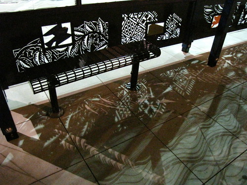 The new bus stops in front of the light rail station feature cut metal artwork. Photo by Wendi.