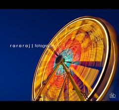 An evening at the local fair... (r a r a r a j | fotography) Tags: longexposure carnival wheel photoshop canon austin giant evening twilight parkinglot colorful texas tx fair rrr 1740mm fotography lightroom giantwheel delldiamond cs3 lseries rathan rebelxti rararaj