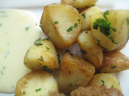Potatoes and cheese sauce