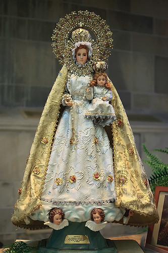 "Statue made of porcelain, cloth, and gems, ""Our Lady of the Philippines"", made in the Philippines, from the collection of the Marianum, photographed at the Cathedral of Saint Peter, in Belleville, Illinois, USA"