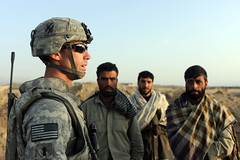 A U.S. Soldier Meets with Private Security Contractors