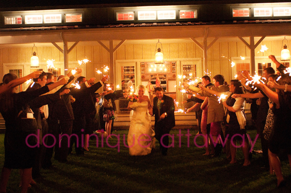 couple exiting wedding sparklers