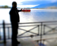 Ioannina, Greece - October 2009 (kexarcho) Tags: autumn red rain boat europa europe afternoon hometown hellas eu greece grecia rainy raindrops balkans europeanunion grece lakefront toyboat ellada tiltshift ioannina redboat giannena epirus   shifttilt             tiltshiftmaker   prefectureofioannina nomosionninon