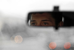 Pedro is driving... (janbat) Tags: france eye water car rain nikon eau europe bokeh pierre pluie 85mm voiture oeil pedro d200 nikkor f18 rétroviseur nantes parebrise jbaudebert