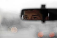 Pedro is driving... (janbat) Tags: france eye water car rain nikon eau europe bokeh pierre pluie 85mm voiture oeil pedro d200 nikkor f18 rtroviseur nantes parebrise jbaudebert