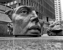 Head Office (sniderscion) Tags: street evan bw sculpture white toronto ontario canada black reflection art broken wet public face bronze scott office nikon branch head centre main low 1996 perspective bank ground canadian pi penny wellington marble split headache dominion snider td d80 flickrgolfclub sniderscion