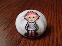 Kumatora button (benjibot) Tags: crossstitch crafts videogames button gba mother3