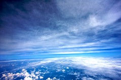 Between The Layers (Samer Farha) Tags: blue sky clouds plane inflight dcist onboard airtran bwibos