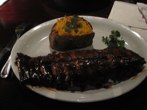 Baked potato and ribs at Bâton Rouge